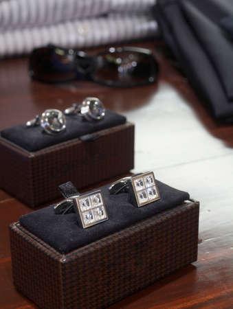 Display of mens diamond and silver cufflinks