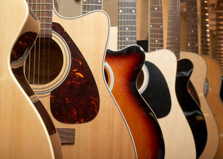 country store: Guitars hanging on wall of music studio Stock Photo