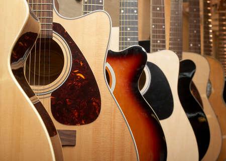 Guitars hanging on wall of music studio Stock Photo