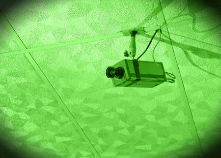 nightvision: Nightvision of surveillance camera hanging from ceiling Stock Photo