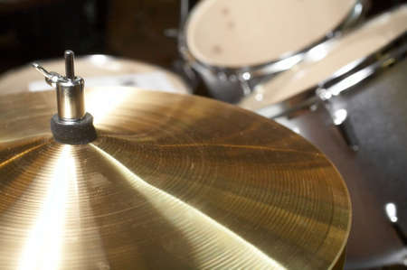 hi-hat cymbal closeup with drumset in background Stock Photo