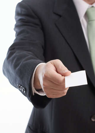 businesscard: Hand of businessman offering businesscard on white background
