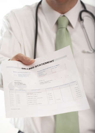 billing: Doctor handing medical billing statement to patient