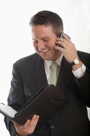 multitasking businessman in suit on phone Stock Photo - 3062764