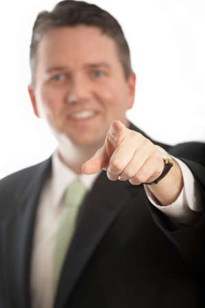 Man in suit pointing at camera DOF focus on hand photo