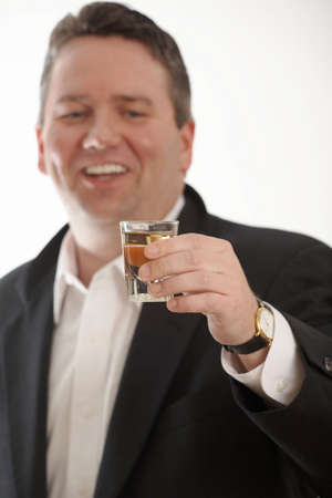 wine trade: Drunk businessman toasting DOF focus on glass Stock Photo