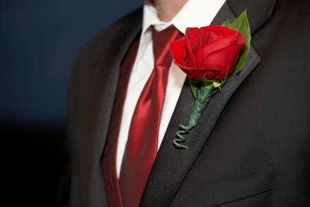 Wedding Red Rose Boutonniere On Suit Jacket of Groom photo