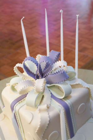 bar mitzvah: Blue and white cake with candles at bat mitzvah Stock Photo