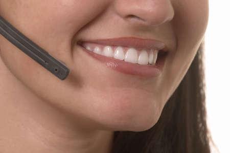 hotline: Beautiful smiling female hotline operator with headset Stock Photo