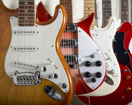 pickups: Electric guitars hanging on wall of music shop