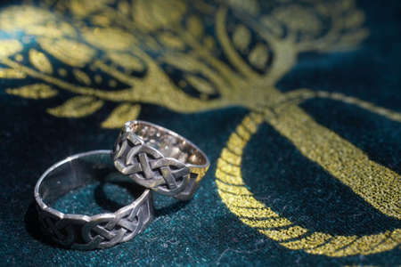 Closeup of celtic wedding bands DOF focus on rings