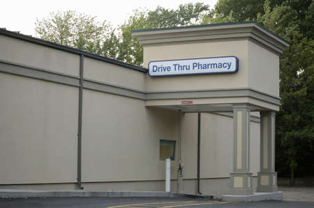 thru: Local drive thru pharmacy building with sign