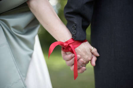 fasting: Hands tied with ribbon at wedding hand fasting ceremony