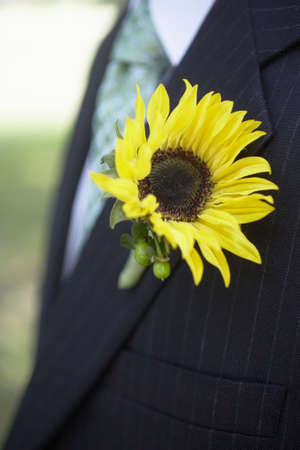 res: Sunflower wedding boutonni�res on suit jacket of groom