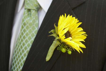 Sunflower  boutonnières on suit jacket of groom Stock Photo