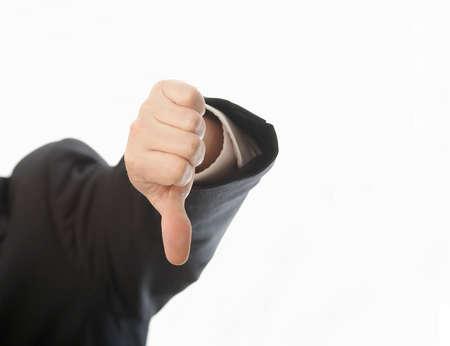 objecion: La mano del hombre en traje que firmar los pulgares hacia abajo  Foto de archivo