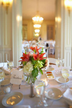 Table set for an event party or wedding reception DOF focus on bouquet