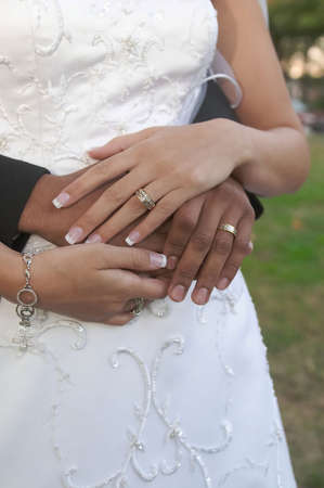 Multiracial bride and groom hands at wedding