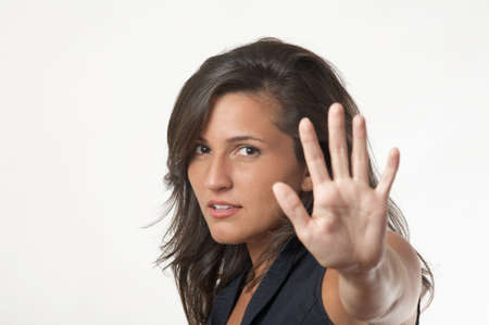 motioning: Young woman motioning to stop focus on face