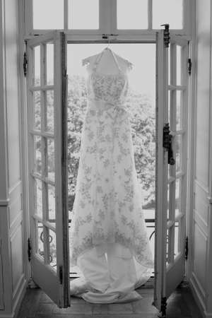 shoppe: White wedding gown hanging in bridal suite