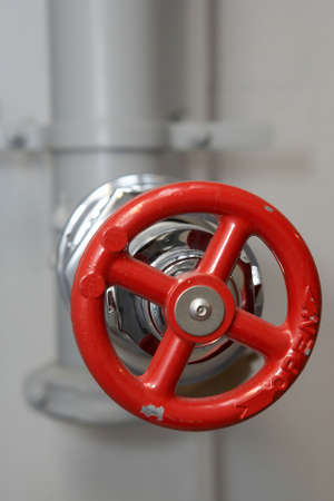 Red water pipe plumbing valve in factory Stock Photo