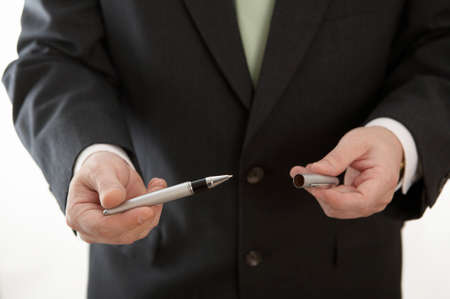 Hand of businessman holding pen to sign contract photo