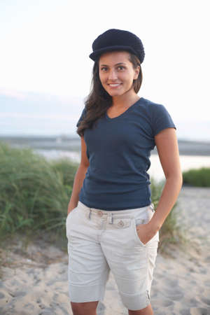 Beautiful smiling young woman at the beach photo
