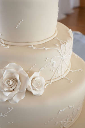 topper: Closeup detail of white wedding cake at reception Stock Photo