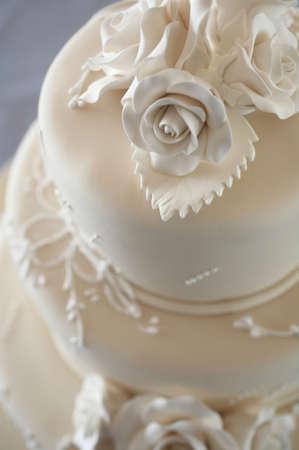 Closeup detail of white wedding cake at reception Stock Photo
