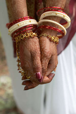 bangles hand: Henna on hands of bride from India