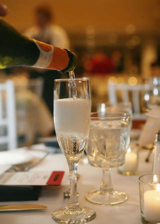 Bottle of champagne poured into a glass Banco de Imagens - 3691263