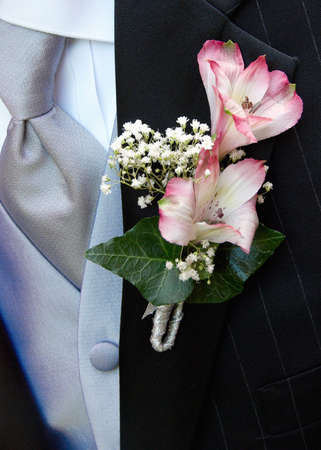 boutonniere: Wedding Boutonniere On Suit Jacket of Groom Stock Photo