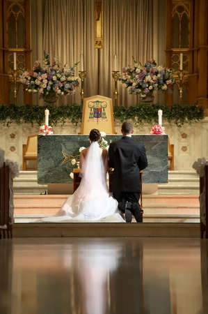 Bride and groom at church wedding alter ceremony