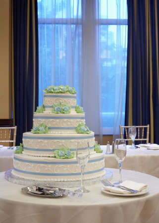 White wedding cake on table at reception