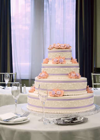 topper: White wedding cake on table at reception