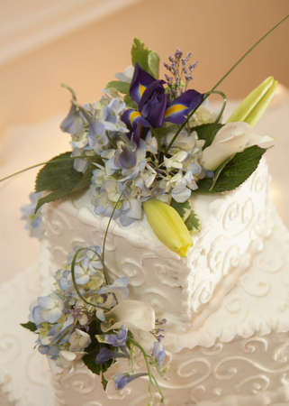 topper: Closeup of white wedding cake at reception