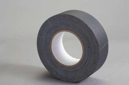 gaffer: Roll of gaffer tape on grey background