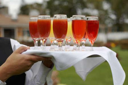 Tray of glasses of drinks being served at fancy party photo