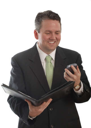 Caucasian businessman in suit smiling while working Stock Photo - 4024817