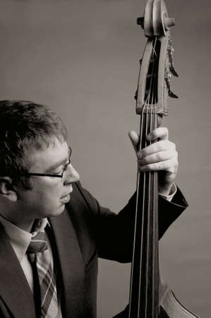 Jazz musician playing upright bass in black and white Stock Photo