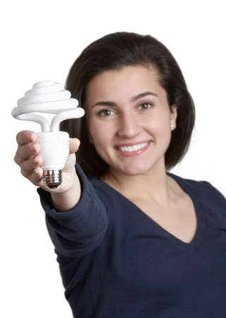 Smiling young woman holding energy saving fluorescent light bulb photo