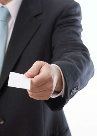 businesscard: Hand of businessman offering businesscard on white