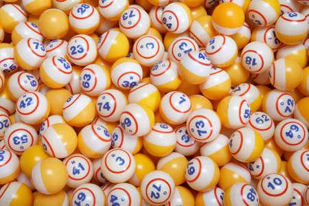 Background of many yellow lottery bingo balls
