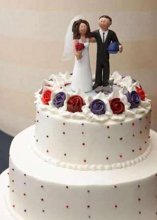 topper: White wedding cake closeup detail at reception Stock Photo