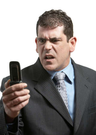 Businessman with bad news on his cell phone Stock Photo - 4557197