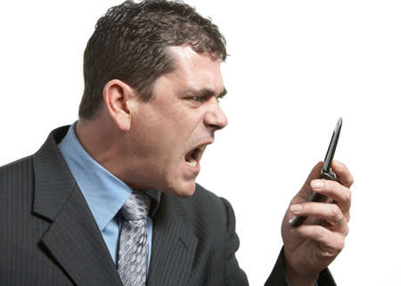Angry businessman yelling on his cell phone Stock Photo - 4539328