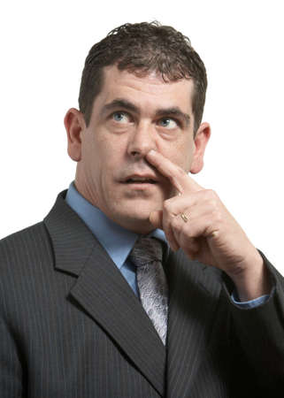 nose picking: Businessman in suit picking his nose on white Stock Photo