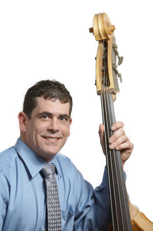 Acoustic bass player leaning against his instrument