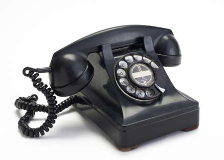 Old vintage rotary telephone on white background