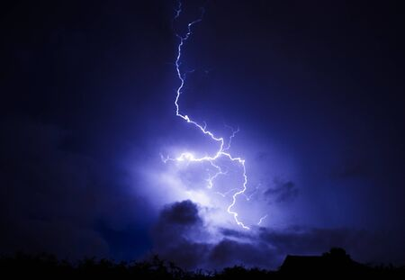 Lightning strike with cloudy sky